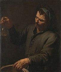 Homme avec bouteille d'urine dans sa main