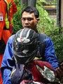 Man on Motorbike - Bangkok - Thailand (34533780892).jpg