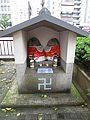 Manji swastika symbol with idols in Kyoto Japan.jpg
