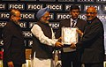 """Manmohan Singh presenting award for excellency to the Chairman, of Steel Authority of India Ltd., Shri S.K. Roongta, in the field of """"Outstanding Achievement In Rural And Community Development"""".jpg"""