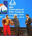Manohar Parrikar felicitating Choreographer Terence Lewis, at the inauguration of the 46th International Film Festival of India (IFFI-2015), in Panaji, Goa. The Minister of State for Information & Broadcasting.jpg