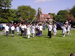 May Day - Children dancing around a maypole as part of a May Day celebration in Welwyn, England