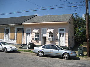 "Dogtrot house - Urban variation of a ""dog-trot"": Creole cottage row house with narrow dogtrot, New Orleans."