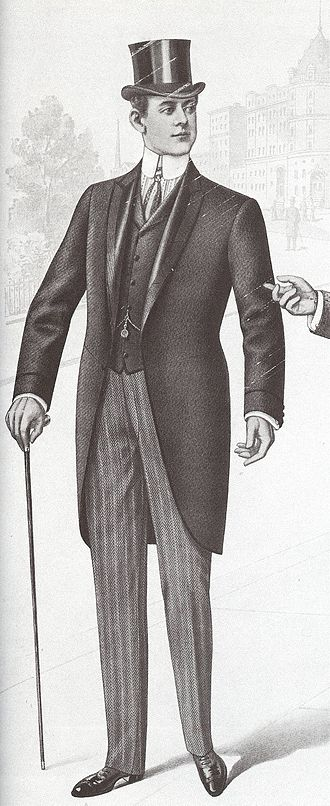 Morning dress - Morning dress with matching black waistcoat with a then-fashionable shorter skirt length, top hat, formal gloves, contrasting-top Oxford boots with punching across the toe cap, boldly striped long tie, striped shirt with contrasting white turn-down collar and cuffs, and formal, striped trousers. The characteristic angle of the cutaway front of the skirt is clearly visible, as is the waist seam. (May 1901)