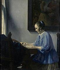 Woman reading music