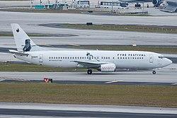 N458UW - Swift Air - Boeing 737-400 - Fyre Festival.jpg