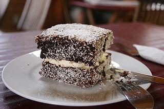 A sponge cake coated in chocolate sauce and coconut