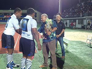 Mosese Volavola - Fiji PM, Frank Bainimarama awarding the trophy to Nadro captains, Setefano Somoca and Mosese Volavola.