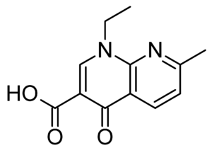 Quinolone antibiotic - Nalidixic acid. Although technically a naphthyridine, it is considered the predecessor of all subsequently developed quinolone antibiotics.