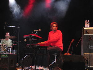 Keyboard amplifier - A keyboardist playing a live show with a big Leslie cabinet (visible to his right).