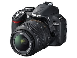 English: Nikon D3100 body with AF-S DX Nikkor ...