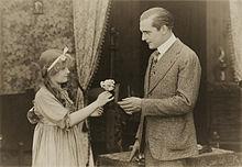 OldHeidelberg 1915 GirlGivingFlower.jpg