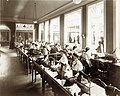 Operators making corsets in the Singer Sewing Machine exhibit in the Palace of Manufactures at the 1904 World's Fair.jpg