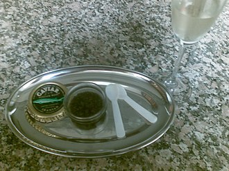 Ossetra - Wild Iranian Ossetra Caviar, ready to serve with mother-of-pearl spoons and Champagne.