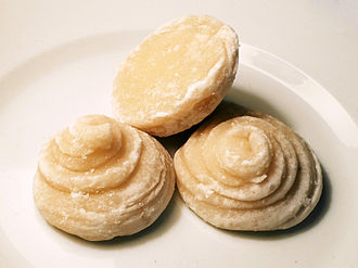 Palm sugar - Three cakes of commercially produced palm sugar