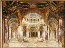 A building interior with many ornate arches. An altar under a dome is almost encircled by a table and a bench.