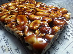 Peanut chikki, a popular foodstuff of jaggery and peanut is available commercially all over India