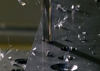 Drilling cutting process that uses a drill bit to cut a hole of circular cross-section in solid materials