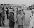 Photograph of President Truman shaking hands with General Dwight D. Eisenhower at the airport in Washington. - NARA - 199132.tif