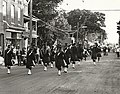 Photograph of members of a pipe band taking part in the Centennial Parade held in Deseronto, Ontario, on Thursday, 17th June, 1971. Taken on Main Street, outside Malley's Variety Store. (5037210814).jpg