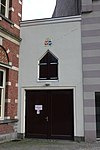 foto van Koetshuis behorende tot het claustrale erf van Kromme Nieuwegracht 39