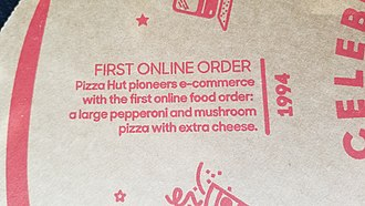 Online food ordering - This is a picture from a 2018 Pizza Hut pizza box, which describes the first online food sale.