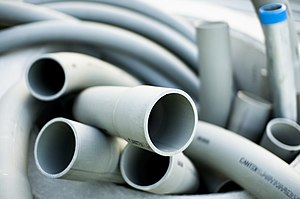 Grey Schedule 40 PVC plastic tubing for use as...