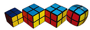 Pocket Cube - From left to right: original Pocket Cube, Eastsheen cube, V-Cube 2, V-Cube 2b.