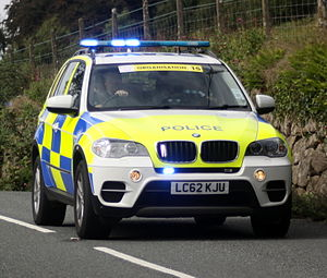 police bmw x5 with active visual warnings showing escorts riders on the tour of britain