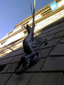 "A ""guard dragon"" sculpture at the Liberal Arts and Policy building watches the southern entrance."