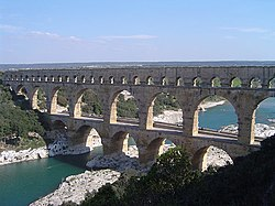 Pont du Gard in France is a Roman aqueduct built in ca. 19 BC. It is one of France's top tourist attractions and a World Heritage Site.