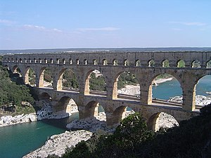 The Pont du Gard in France is a Roman aqueduct built in ca. 19 BC. It is one of France's top tourist attractions and a World Heritage Site.