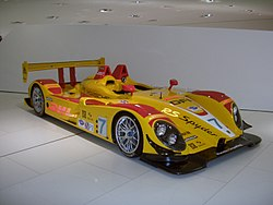 Picture of bright yellow and red RS Spyder racing car in a museum