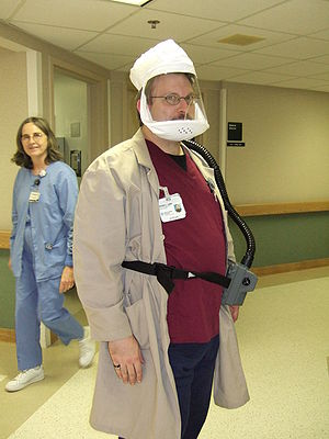 HEPA - Hospital staff modelling a powered, air-purifying respirator (PAPR) fitted with a HEPA filter, used to protect from airborne or aerosolised pathogens such as tuberculosis