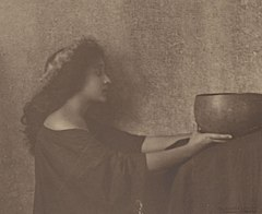 Portrait of young Italian-Hawaiian woman holding large bowl titled 'The Calabash' 1909.jpg
