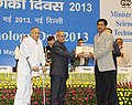 Pranab Mukherjee presenting the Biotech Product & Process Development and Commercialisation Award for 2013 to Dr. Samit Kumar Nandi from West Bengal University of Animal & Fishery Sciences.jpg