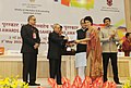"""Pranab Mukherjee presenting the Rajat Kamal Award for Best AnthropologicalEthnographic Film """"Qissa – e – Parsi The Parsi Story"""" in Non Feature Films Section to the Director, Ms. Divya Cowasji.jpg"""