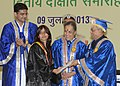 Pranab Mukherjee presenting the degree to a student, at the Second Convocation of the Central University of Rajasthan, at Kishangarh, in Rajasthan. The Governor of Rajasthan.jpg