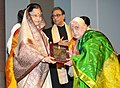 Pratibha Devisingh Patil presenting the Sangeet Natak Akademi Award-2009 to Smt. Parassala B. Ponnammal for her outstanding contribution to Carnatic Vocal music.jpg
