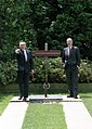 President George H. W. Bush and President Nursultan Nazarbaev of Kazakhstan pitch horseshoes.jpg