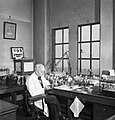 Professor Alexander Fleming at work in his laboratory at St Mary's Hospital, London, during the Second World War. D17801.jpg