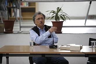 Ramachandra Guha - Guha delivering a talk at The Doon School's Kilachand Library in 2017.