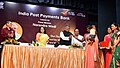 Ravi Shankar Prasad distributing the QR Card to one of the account-holders Smt. Suparna Bhowmick, at the launch of the India Post Payments Bank (IPPB), in Kolkata.JPG