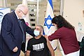 Reuven Rivlin with the first vaccinator in Phase B of the Israeli Vaccine of the Israeli Biological Institute, January 2021 (GPOABG 4045).jpg
