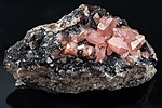 Rhodochrosite on Matrix - Peru.jpg
