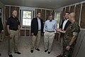 Richard Burr, Thom Tillis, John Boozman, and Scott Baldwin tour base housing on Marine Corps Base Camp.jpg