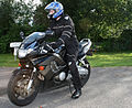 Rider in black textile suit and blue helmet on Honda CBR600.jpg