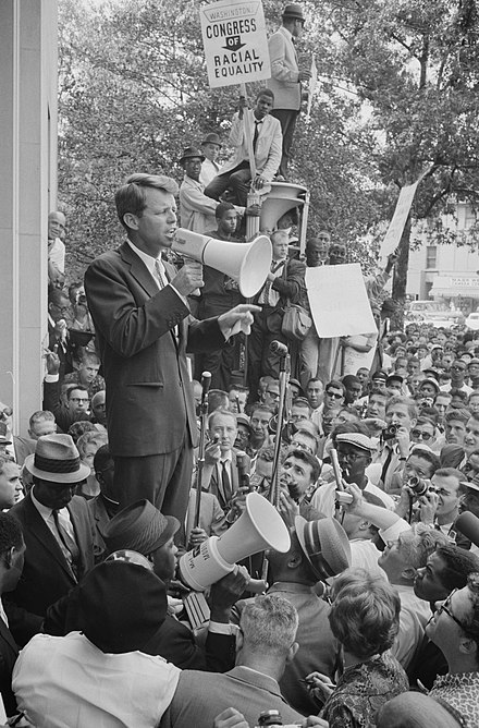 Attorney General Robert Kennedy speaking before a hostile Civil Rights crowd protesting low minority hiring in his Justice Department June 14, 1963 Robert Kennedy speaking before a crowd, June 14, 1963.jpg