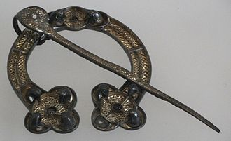 Celtic brooch - The Rogart brooch, National Museums of Scotland, FC2. Pictish penannular brooch, Scotland, 8th century, silver with gilding and glass.  Classified as Fowler H3 type.