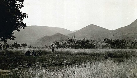 A 1928 photograph from northern Urundi Ruana-Urundi. Landscape with a group of native people from the northern part of Urundi, 1928. (9422840698).jpg